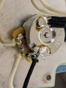 Here is an example of OEM wiring with cold solder joints.